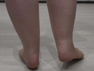'legs of a mature lady in nylon pantyhose and high heeled shoes'