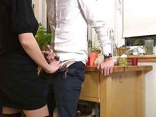 Cute blonde MILF jerking and rimming in the kitchen