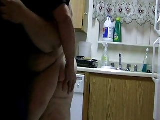 BBW housewife doing the dish