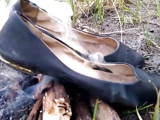 Wife burning her old flats and tights and me stomp on ashes.