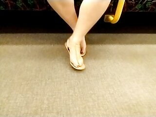 Taunting my soles In beautiful sandals on the teach