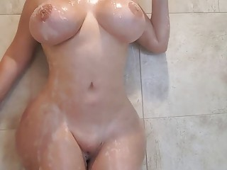 Curvaceous babe masturbates in the shower before being fucked hard
