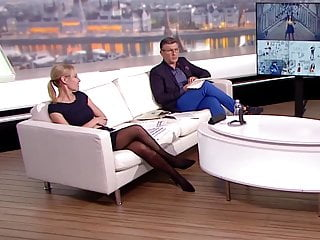 Long legged tv host in black pantyhose and heels 9