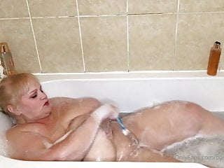 Mature big tits taking a bath