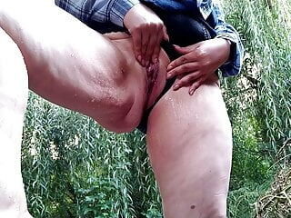 Cougar in a brief microskirt jacks and urinates while standing