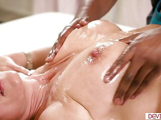 A huge-chested cougar gives a tit job, then gets boned by her ebony masseuse