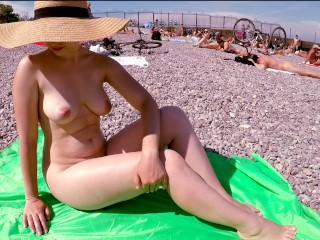 Naked beach summer day! Piss and sunbathed on public beach and then wanked off beau schlong