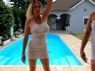 Big-titted mommy striptease at the pool