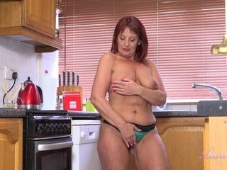 Redhead Mature Masturbates In The Kitchen