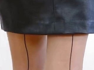 Black skirt, pantyhose and heels